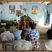 Nurse, Gossan Anonman, delivering an education session about Maternal and Newborn Tetanus (MNT) at a church in Yapleu in western Cote d'Ivoire.