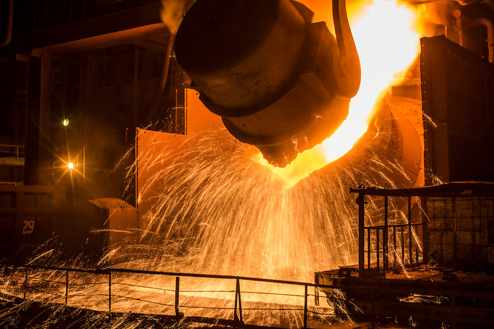 Molten iron is poured into the converter at the Azovstal Iron and Steel Works on Friday, March 18, 2016 in Mariupol, Ukraine.