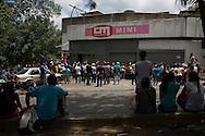 2016/05/26 - Caracas, Venezuela: People queue in front of Mini Central Madeirense Super Market in La Urbina neighbourhood in Caracas. (Eduardo Leal)