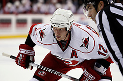 Oct 17, 2009; Newark, NJ, USA; Carolina Hurricanes center Eric Staal (12) gets ready to faceoff during the third period at the Prudential Center. The Devils defeated the Hurricanes 2-0.