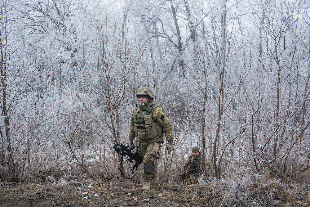 ARTEMIVSK, UKRAINE - FEBRUARY 15: Ukrainian soldiers on the road leading to the embattled town of Debaltseve on February 15, 2015 outside Artemivsk, Ukraine. A ceasefire scheduled to go into effect at midnight was reportedly observed along most of the front, save for near the embattled town of Debaltseve. (Photo by Brendan Hoffman/Getty Images) *** Local Caption ***