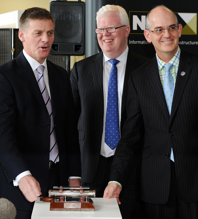 Minister of Finance Bill English, left, rings the bell at the launch of Mighty River Power Shares on the NZX with the NZX CEO Tim Bennett and Minister of State Owned Enterprises Tony Ryall, Wellington, New Zealand, Friday, May 10, 2013. Credit:SNPA / Ross Setford