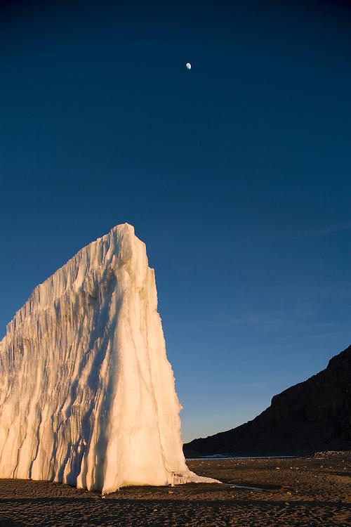 Africa, Tanzania, Kilimanjaro National Park, Setting sun lights ice walls of receding glaciers in Mount Kilimanjaro's 18500 foot crater floor