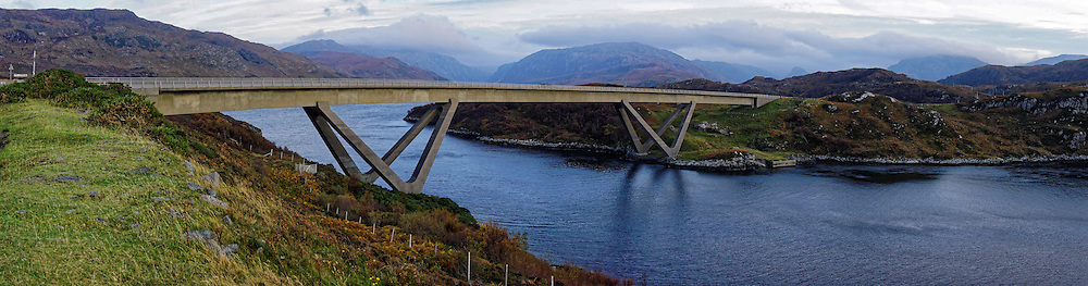 Opened in 1984, the Kylesku Bridge is a distinctively curved concrete box girder bridge in north-west Scotland that crosses the Loch a' Chàirn Bhàin in Sutherland.