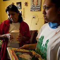 26 April 2009,  Mexico City, Mexico--- - The mother and grandmother of Oscar Perez stand with a photograph of the 5 year old and an urn with his ashes in thier apartment.    --- Image by © Trevor Snapp