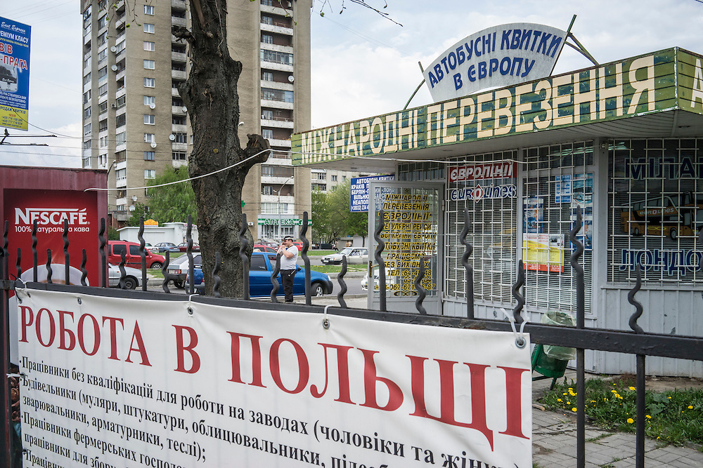 A sign near the bus station advertises for workers in Poland on Tuesday, April 28, 2015 in Lviv, Ukraine. CREDIT: Brendan Hoffman/Prime for the Wall Street Journal UKRMIGRATION