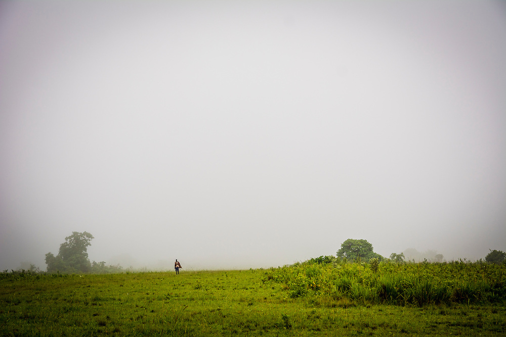 A Didinga cattle herder walks through the fog. While the temperatures down on the plains can soar to above 40ºC the villages higher up enjoy a more temperate climate.