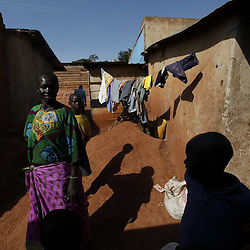 mapjd picture essay uganda slums   images   darrin zammit lupi    inhabitants walk through a street at the internally displaced persons camp at mbuya  on the