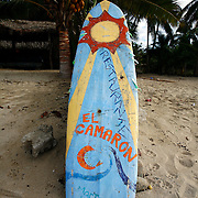 "SHOT 1/18/2007- A surfboard advertises a seafood restaurant along the beach in Sayulita, Mexico. Sayulita is a small fishing village about 25 miles north of downtown Puerto Vallarta in the state of Nayarit, Mexico. Known for its rivermouth surfbreak, roving surfers ""discovered"" Sayulita in the late 60's with the construction of Mexican Highway 200. Today, Sayulita is a prosperous growing village of approximately 4,000 residents. Hailed as a popular off-the-beaten-path travel destination, Sayulita offers a variety of activities such as horseback riding, hiking, jungle canopy tours, snorkeling and fishing. Still a mecca for beginner surfers of all ages, the quaint town attracts upscale tourists with its numerous art galleries and restaurants as well. Sayulita has a curious eclectic quality, frequented by native Cora and Huichol peoples, travelling craftsmen (and women) as well as by international tourists. Sayulita is the crown jewel in the newly designated ""Riviera Nayarit"", the coastal corridor from Litibu to San Blas. It's stunning natural beauty and easy access to Puerto Vallarta have made Sayulita real estate some of the most sought after in all of Mexico..(Photo by Marc Piscotty © 2007)"