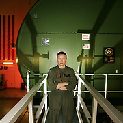 First Lieutenant Katie Horner is one of the first female pilots to have been deployed into combat situations, serving two tours in Iraq flying a Cobra attack helicopter. Here she stands in front of one of Camp Lejune's Helicopter flight simulators.