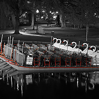 This selective color B&amp;W New England photography image of an iconic Boston Swan Boat after sunset is available as museum quality photography prints, canvas prints, acrylic prints or metal prints. Prints may be framed and matted to the individual liking and decorating needs: <br />