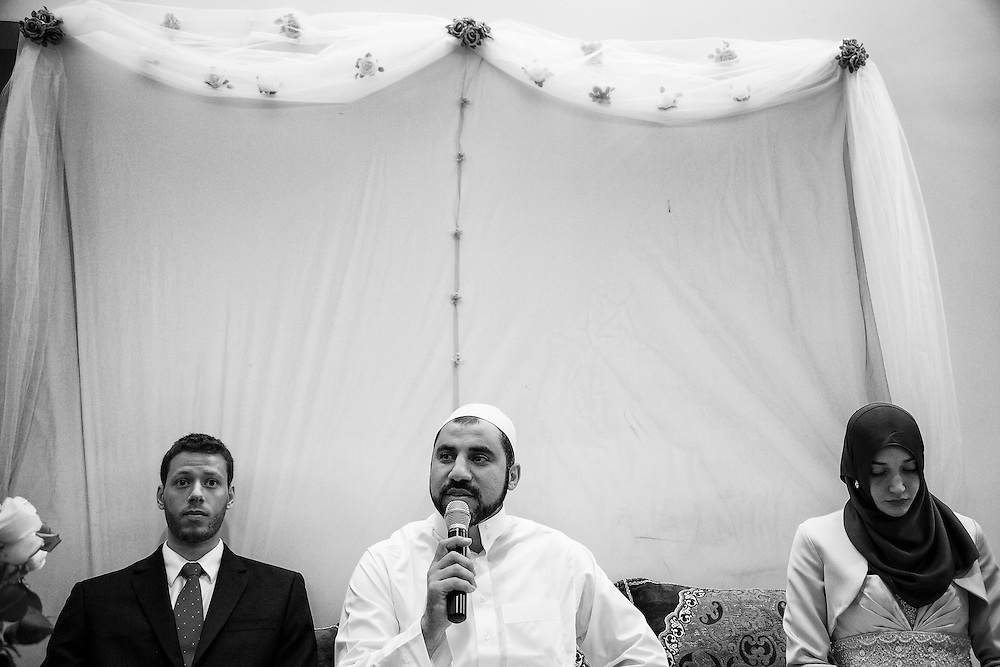 An imam makes speech for a couple to celebrate their engagement at the party as gloom and bride gets nervous.
