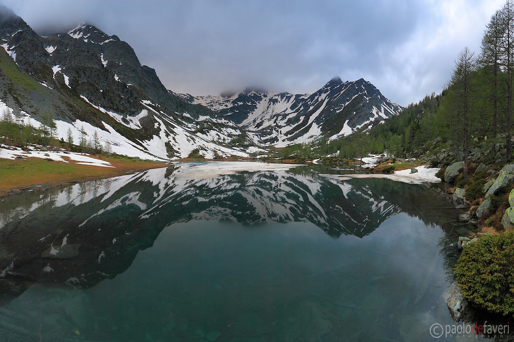 This is the lake of Arpy, a small glacial lake at 2000+ m. of elevation above Morgex in Valle d'Aosta, Italy, very near to the Monte Bianco range. Since it was mid of June 208, I didn't expect to still find some ice on the lake surface, that was a nice surprise indeed. Really a die hard winter, that year...