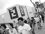 Japanese and Asian tourists walk past the Fendi and Chanel fashion stores in Tumon, Guam, on Saturday, Mar. 10, 2007.  Sometimes known as 'America in Asia', Guam is a popular destination for Japanese tourists ( accounting for approx 90% of the island's visitors) with average visitor numbers from Japan approaching 1million.  The island, a 3.5 hour flight from Japan, has more than 20 large hotels and numerous duty-free shopping malls catering to the Japanese tourists predilection for designer brand name goods, as well as golfing and other water based entertainment features. In 2007-2008 US military personal currently stationed in the Japanese Okinawan Islands will relocate their bases and operations  to Guam, helping to stabilise the island's economy which suffered after tourism decreased in recent years due to a  fear of flying by Japanese post 9-11 World Trade Centre disaster, a 2003 typhoon and the SARS disease outbreak in Asia.