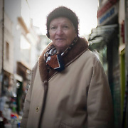 Kaliopi, 83 has lived her life in Psiri, she is a widow and helps her son operate his music store. She says times are too tough now, we had a simpler life, a time where things were happier even having gone through the war. Image © Angelos Giotopoulos/Falcon Photo Agency