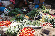 A woman sells an assortment of vegetables on the street.  The slum of Cheetah Camp on the outskirts of Mumbai, India is a predominantly muslim community on living on the fringe while the city continues to grow.