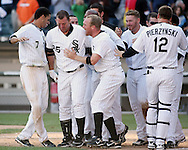 CHICAGO - SEPTEMBER 16:  Teamates mob Jim Thome #25 of the Chicago White Sox after hitting his 500th career home run, a walk off home run winning the game, off of Dustin Moseley #58 during the game against the Los Angeles Angels at U.S. Cellular Field in Chicago, Illinois on September 16, 2007.  The White Sox defeated the Angels 9-7.  (Photo Credit Ron Vesely)