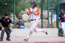 Rob Hermann erupts while scoring a go-ahead run during the first game of the 2015 French Finals.