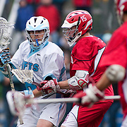 05/18/2011- Medford/Somerville, Mass. - Tufts midfielder Geordie Shafer (A12) tries to turn past Cortland State midfielder Pat Hayes in the Jumbos 10-9 win over Cortland State in the NCAA Tournament Quarterfinals at Bello Field on May 18, 2011. (Kelvin Ma/Tufts University)