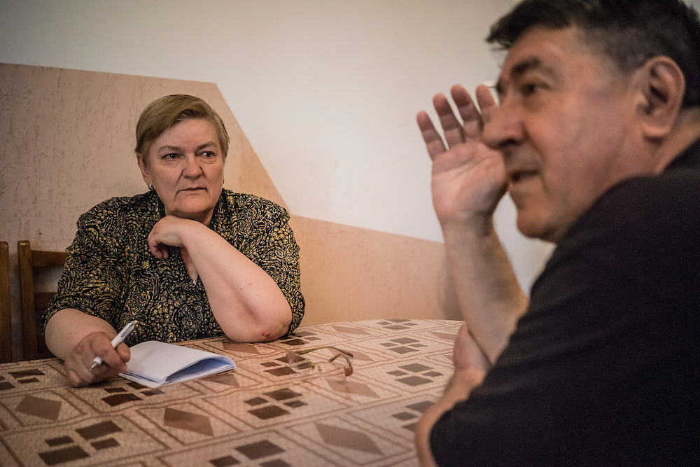 Ewa Holodkova, 67 (left) and her husband Anatoliy Holodkov, 74, from the town of Stakhanov in Lugansk oblast, speak with a reporter on Tuesday, April 28, 2015 in Lviv, Ukraine. Despite Ewa being a Polish citizen and the couple having the legal right to live in Poland, where they have a daughter, their Ukrainian pensions are too small to afford life in Poland. CREDIT: Brendan Hoffman/Prime for the Wall Street Journal UKRMIGRATION