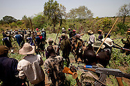 Elder warriors in the Jie tribe celebrate the return of a child abducted by the nearby Murle tribe and prepare for clashes after a Murle man killed a Jie man in a drunken fight in Boma.