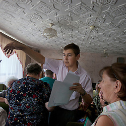 Mykola Glotov, an attorney, helps during a Òspecial consultationÓ for potential clients who are children of the Second World War, Rivne, Ukraine, June 15, 2011. This vulnerable group is made up of seniors, most of whom are not receiving proper compensation as promised by the government. The legal team advises them on how to properly fill out forms and submit them to the courthouse, while encouraging them not to give up on their rights. More than half of the worldÕs population, four billion people, live outside the rule of law, with no effective title to property, access to courts or redress for official abuse. The Open Society Justice Initiative is involved in building capacity and developing pilot programs through the use of community-based advocates and paralegals in Sierra Leone, Ukraine and Indonesia. The pilot programs, which combine education with grassroots tools to provide concrete solutions to instances of injustice, help give poor people some measure of control over their lives.