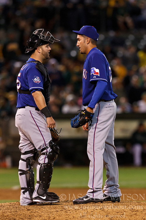 OAKLAND, CA - JULY 17: Mike Napoli #25 of the Texas Rangers (left) talks to Mike Adams #37 (right) during the eighth inning against the Oakland Athletics at O.co Coliseum on July 17, 2012 in Oakland, California. The Texas Rangers defeated the Oakland Athletics 6-1. (Photo by Jason O. Watson/Getty Images) *** Local Caption *** Mike Napoli; Mike Adams