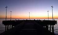 Venice Beach pier during  a November sunset.