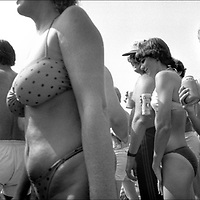 Beer, Beach & Bikinis - In California, you don't often see that much actual beer on the beach, but on this hot day in 1985 there was beer and bikinis everywhere. Photographed at the Men's AVP @avpbeach $21,000 Jose Cuervo World Championships on September 14-15, 1985 in Redondo Beach, California. From Widelux Beach available at Kim Reilly Arts on Manhattan Ave. in Manhattan Beach, California. (310) 372-3681