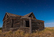 The Big Dipper over an abandoned pioneer house, near Bow Island, Alberta, with the scene lit by the almost Full Moon, July 30, 2015. This is a single frame from a 300-frame time-lapse dolly sequence.