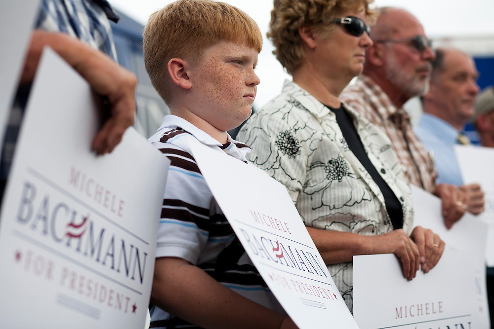 People listen to Republican presidential hopeful Michele Bachmann at a campaign stop on Tuesday, August 9, 2011 in Humboldt, IA.