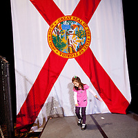 TAMPA, FL -- Angelica Doster, 4, plays on the stage with her sister Isabella, 2, after Republican presidential candidate former Gov. Mitt Romney spoke to supporters during his Election Night party on decision day during his victory in the Florida Primary on Tuesday, January 31, 2012. (Chip Litherland for The New York Times)