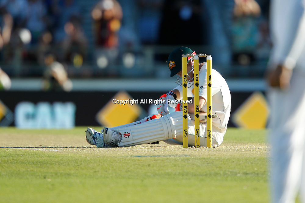03.11.2016. Perth, Australia. International cricket, 1st Test  Day One Australia versus South Africa. David Warner sits on the pitch after falling when hitting a four.