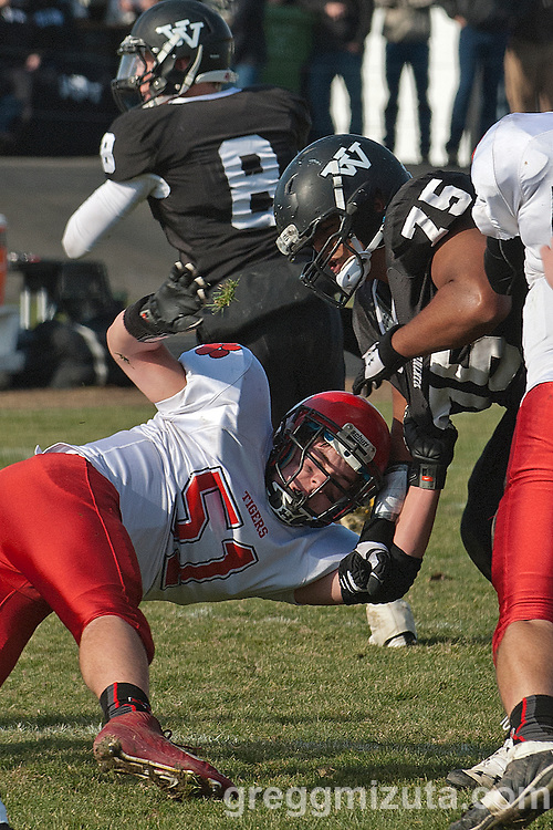Vale junior Kye Yraguen blocks Clatskanie's Bodenhamer as quarterback Josh Schoorl sets to pass during the round 1 playoff game, November 9, 2013 at Frank Hawley Stadium Vale High School, Vale, Oregon. Vale won 46-0.