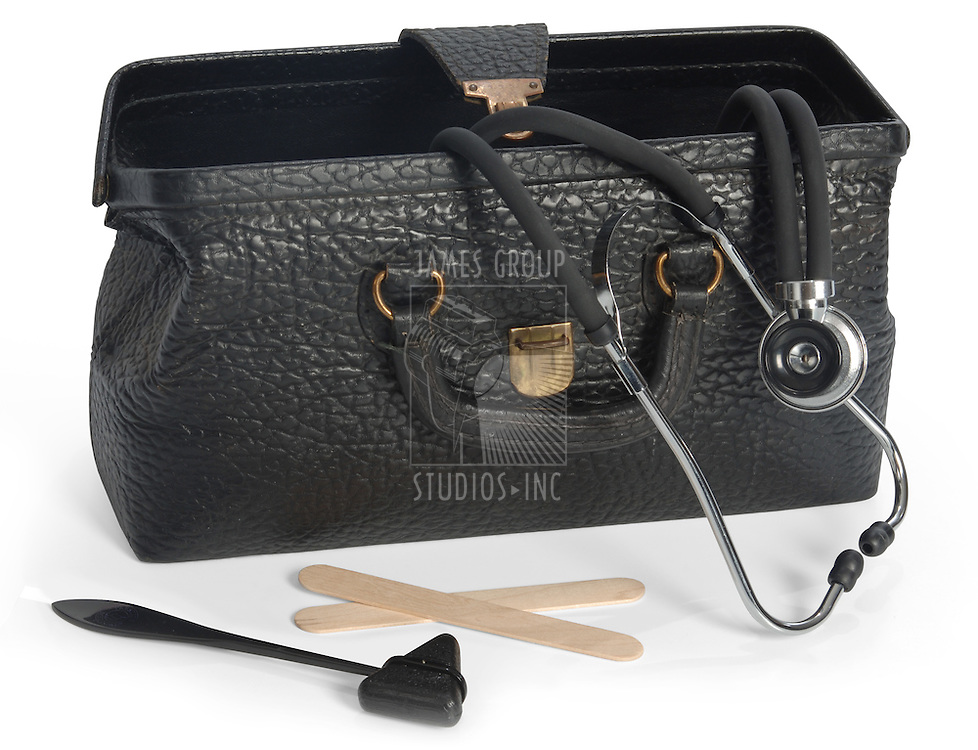 Open vintage medical bag with stethescope, reflex hammer and tongue depressors and clipping path