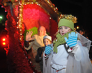 Piper Clark waves from The Regents School float at the Christmas parade in Oxford, Miss. on Monday, December 6, 2010.