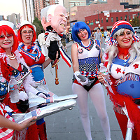 "A group of women outside the DNC dressed up as cartoonish patriotic girls ""from Crawford, Texas."""