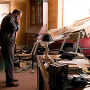 Photo by Gary Cosby Jr.  Bradley Griggs talks on his cell phone in Pastor Dusty McLemore's office at Lindsay Lane Baptist Church after a car crashed through the wall Thursday afternoon.  McLemore was not in the office at the time of the wreck.