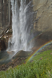 A rainbow forms from the mist off Vernal falls in Yosemite National Park, California.