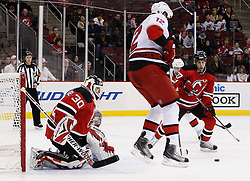 Oct 17, 2009; Newark, NJ, USA; New Jersey Devils goalie Martin Brodeur (30) makes a save through a screen by Carolina Hurricanes center Eric Staal (12) during the third period at the Prudential Center. The Devils defeated the Hurricanes 2-0.