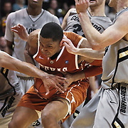 SHOT 2/26/11 4:34:53 PM - Texas' Gary Johnson (#1) is surrounded by Colorado players under the basket during their regular season Big 12 basketball game at the Coors Events Center in Boulder, Co. Colorado upset the fifth ranked Texas 91-89. (Photo by Marc Piscotty / © 2011)