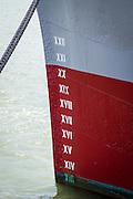 Deail shot of hull markings on a docked vessel.