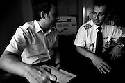 Two pilots reference the days briefing on how things will go throughout the day. Image © Angelos Giotopoulos/Falcon Photo Agency