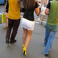 RUSSIA - Russland - MOSCOW, MOSKAU , woman with heigh heels and boys on TVERSKAYA street     © Christian Jungeblodt