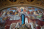 A statue of the Blessed Mother stands in the foreground of one of artist Raphael's famous frescoes featured in the Vatican Museums. (Sam Lucero photo)