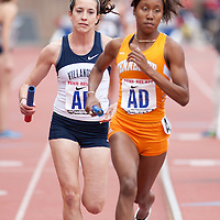 Sheila Reid of Villanova University attempts to pass Brittany Sheffey of the University of Tennessee during the anchor leg of the College Women's Distance Medley Championship during the Penn Relays athletic meets on Thursday, April 26, 2012 in Philadelphia, PA.