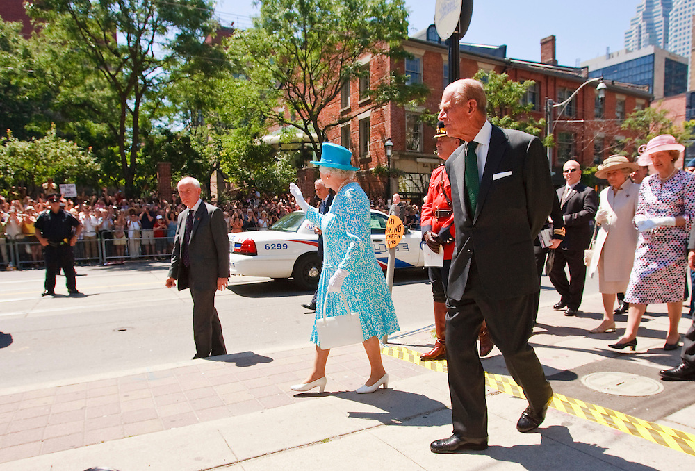 Queen Elizabeth II waves to the crowd as she and Prince Philip, The Duke of Edinburgh leave St. James' Cathedral in Toronto, Canada, following Sunday service July 4, 2010.<br /> AFP/GEOFF ROBINS/STR