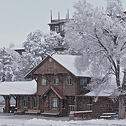Scenic winter photo of falling snow covering the historic Grand Canyon Train Depot.