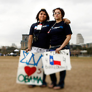 Volunteers Andriana Montes and Angel Derer(R) attend a rally held for U.S. Senator Barack Obama in Austin, Texas, February 23, 2007.