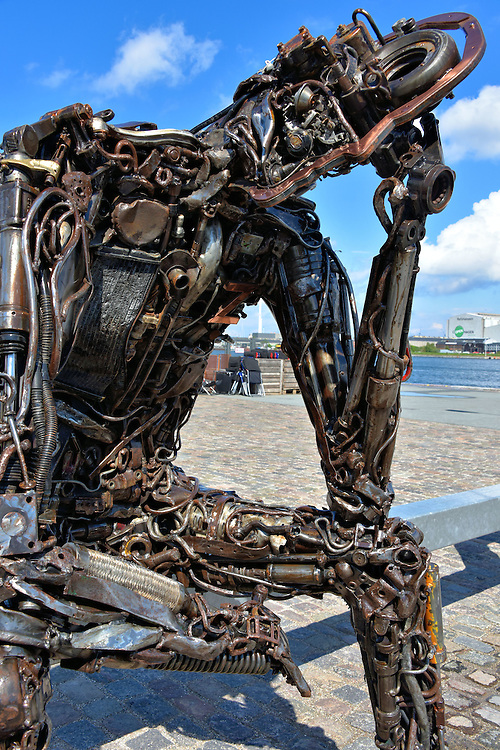 Zinkglobal Artwork by Kim Michael in Copenhagen, Denmark <br /> Copenhagen is filled with beautiful and historic sculptures plus an occasional modern and humorous one like Zinkglobal. An obvious parody of the famous 1904 bronze statue &ldquo;The Thinker&rdquo; by Auguste Rodine, this contemplative figure is constructed with scrap metal and sits on top of a metallic &ldquo;The Key to the Future.&rdquo;  The outdoor artwork, which is displayed at Nordre Toldbod along the harbor, is by Kim Michael who refers to himself as TheZinker.